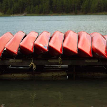 overturned: Canoes overturned on a dock, Jasper National Park, Canada