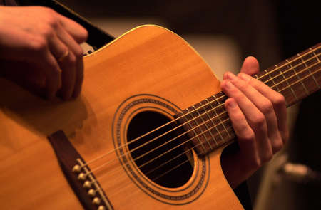 tuneful: Guitar being played Stock Photo