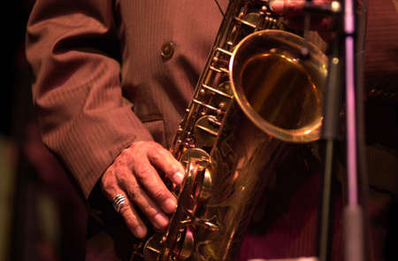 tuneful: Musician playing a Saxophone