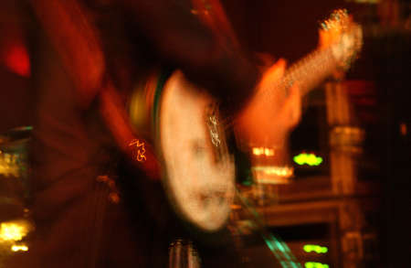 tuneful: Blurred image of a Musician playing a Guitar