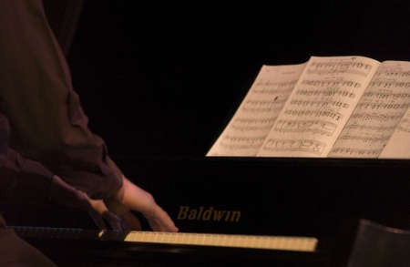 ivories: Musician playing a piano