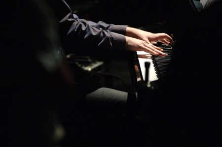 tuneful: Musician playing a piano