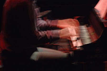 tuneful: Blurred image of Musician playing a piano