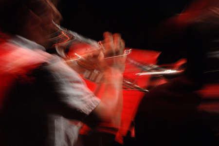 tuneful: Blurred image of a Musician playing a Trupet Stock Photo