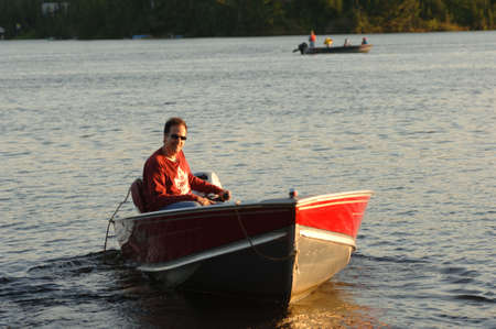Man driving motorboat on lake Stock Photo - 254508