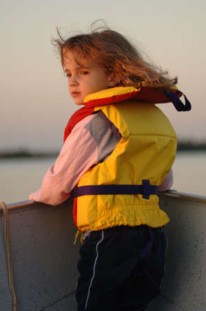 lifejacket: Blond girl in yellow lifejacket Stock Photo