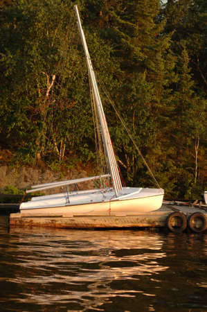 liesure: Sailboat docked at Lake of the Woods