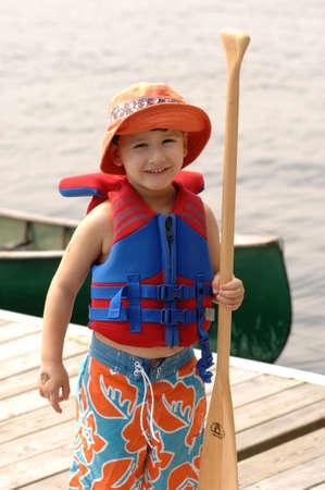 oar: Small child holding an oar