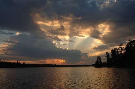 Sunlight through clouds at twilight Stock Photo - 254706