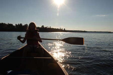 oar: Silhouette of a woman holding an oar