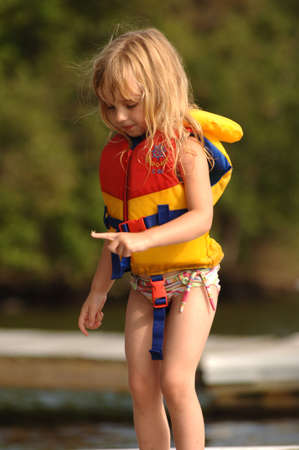 lifejacket: 4 year old in a lifejacket Stock Photo