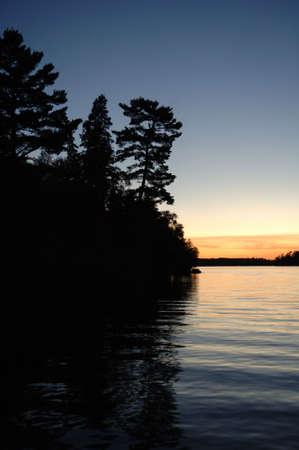 Silhouette of shoreline against twilight sky Stock Photo - 254787