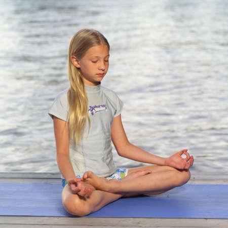 Teenage girl doing yoga Stock Photo - 254895