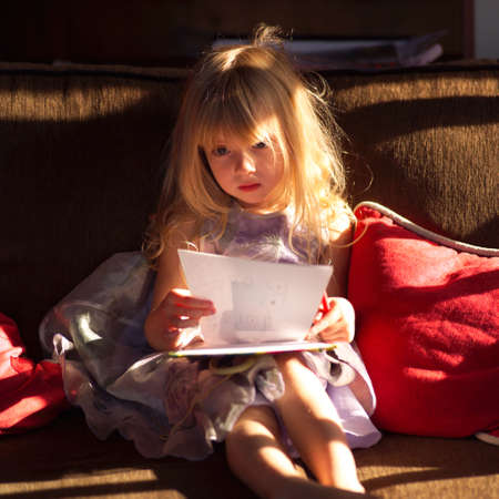 throw cushion: 5 year old looking at a page of paper