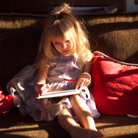 throw cushion: 5 year old looking at a book
