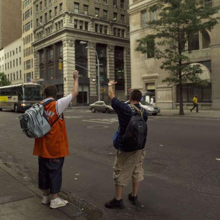 hailing: Two men hailing a cab, New York City