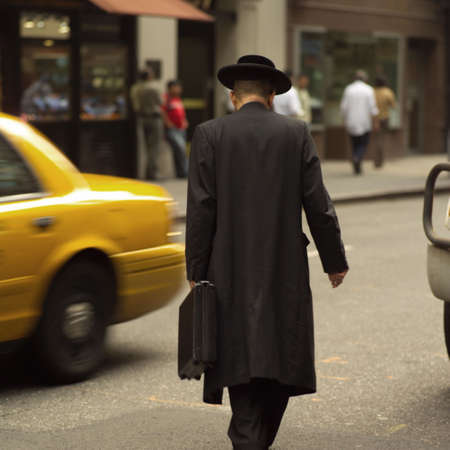 hasidic: Hasidic Jewish man walking down street, New York City Stock Photo