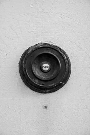 """A black-and-white photograph of an old doorbell button marked """"PRESS� Stockfoto"""