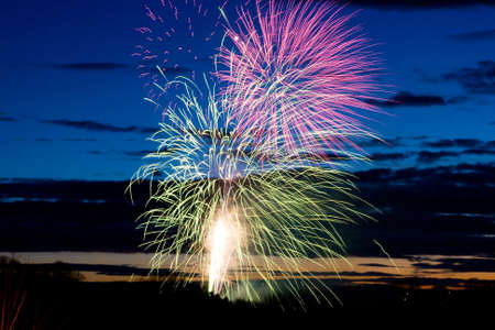 Bright and coloufull fireworks with cloudy night time sky photo
