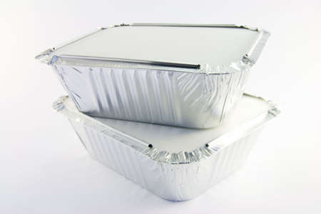 Two square foil catering trays on a white background