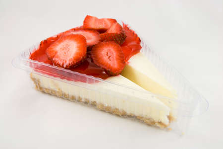 Two slices of Strawberry cheesecake in a plastic container with a white background Stock Photo - 4813507