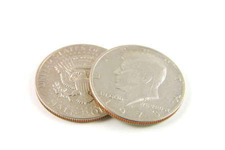 american silver eagle: closeup of two american 1973 half dollars showing bot the head and tail sides on a white background