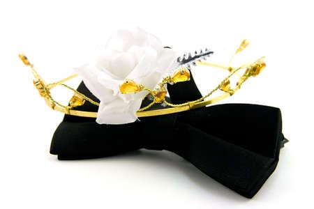 Single Black Bow Tie with Tiara and single white rose on a white Background photo