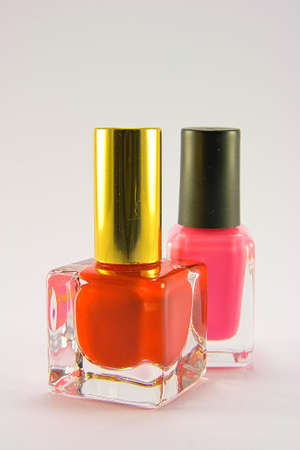 Bottles of red and pink nail polish on a plain background Stock Photo - 4918742