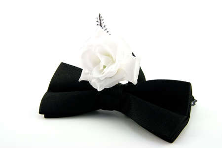 Black Bow Tie with Single Rose on a white background photo