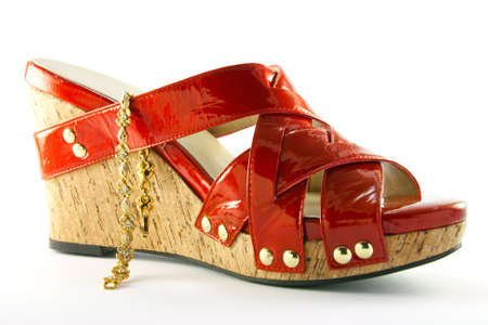 Single red shoe and gold bracelet Stock Photo - 5096543