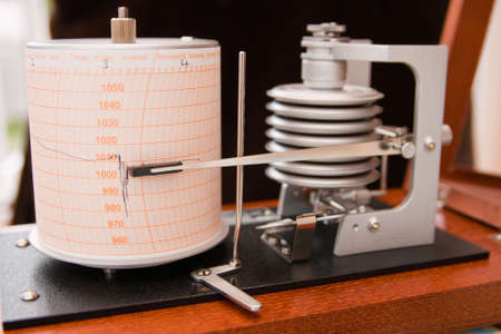 atmospheric pressure: Barograph in a wooden box with the lid open