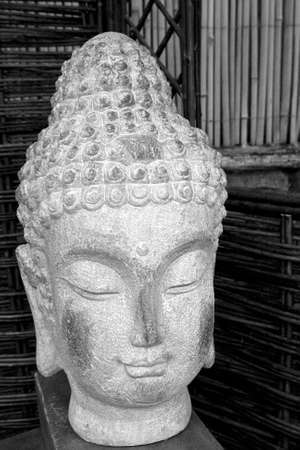 Black and white buda head statue made of stone situated in a garden Stock Photo - 5199013