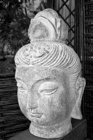 Black and white buda head statue situated in a garden Stock Photo - 5217637