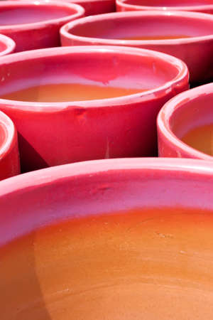 a collection of bright red and purple glazed flower pots Stock Photo - 5217653
