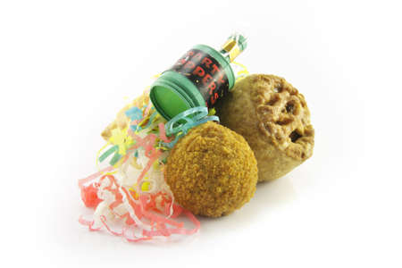 Small tasty pork pie, small round scotch egg and streamers with party popper on a reflective white background Stock Photo - 5890864