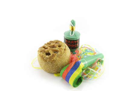 party popper: Small tasty pork pie with party blower and party popper with streamers on a reflective white background