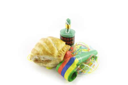 party popper: Small tasty sausage roll with party blower and party popper with streamers on a reflective white background