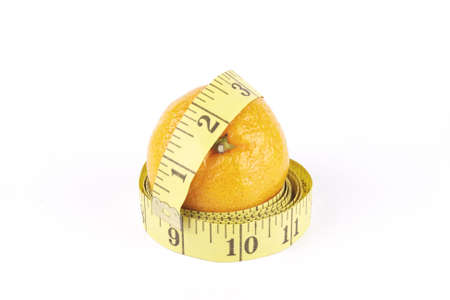 satsuma: Small single satsuma with tape measure wrapped around on a reflective white background