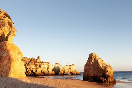 deserted: algarve beach deserted at sunset Stock Photo