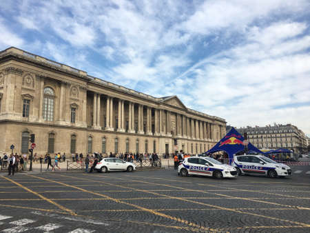 squad: Paris France, 23 September 2017: Police cars in front of Palais du Louvre Palace and Museum in Paris Editorial