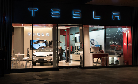 Chengdu Hubei China, 22 November 2017: Tesla inc cars flagship store in Chengdu China with Tesla logo and an electric car model X inside