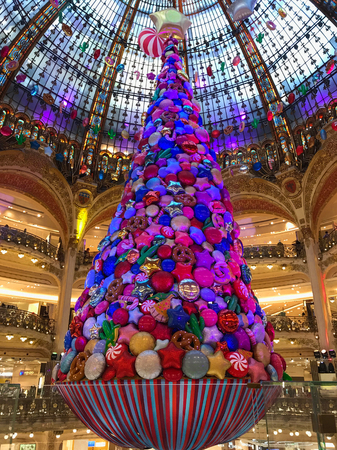 Paris France, 16 November 2017: Giant Christmas tree decoration inside Galeries Lafayette Parisian department store
