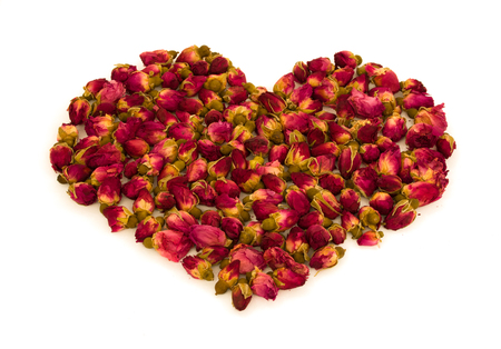 Heart shape made of rosebuds flowers isolated on white background - love symbol concept Foto de archivo