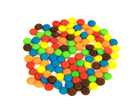 colorful button shaped chocolates candy isolated on white background Stock Photo