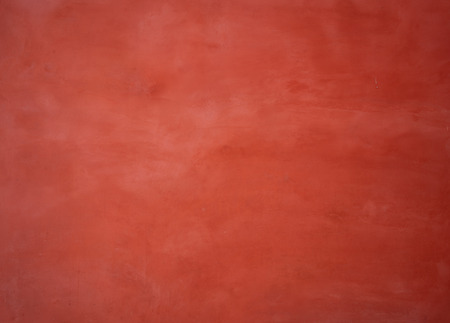 Red painted wall background with washed-out color Reklamní fotografie