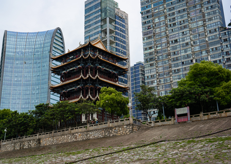 View of Zhenjiang pavilion on Yangtze riverside and buildings in background in Yichang Hubei China Banco de Imagens