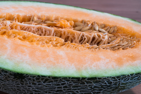 Chinese Hami melon cut in half close up flesh view