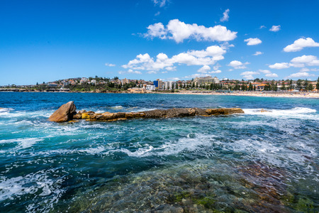 Pacific Ocean view in Sydney with beautiful prominent rocks and Coogee beach in background in NSW Australia Фото со стока - 115774033
