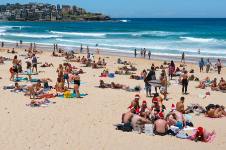 24th December 2018, Bondi Sydney Australia: Group of young men wearing Santa hats on Christmas eve on Bondi beach Sydney Australia Editorial