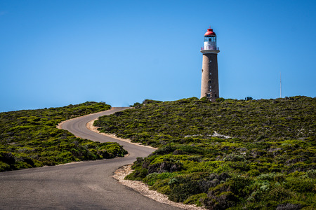 Lighthouse with red top and winding road at Cape du Couedic on Kangaroo island in SA Australia